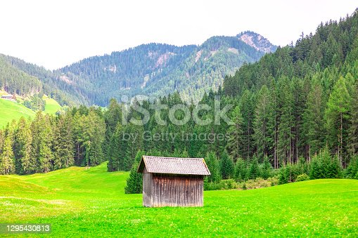 istock Alpine pasture with wooden barn 1295430813