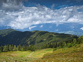 HDR photo showing beautiful Alpine pasture in the foreground with high Carinthian mountains in the background, Austra, Europe.