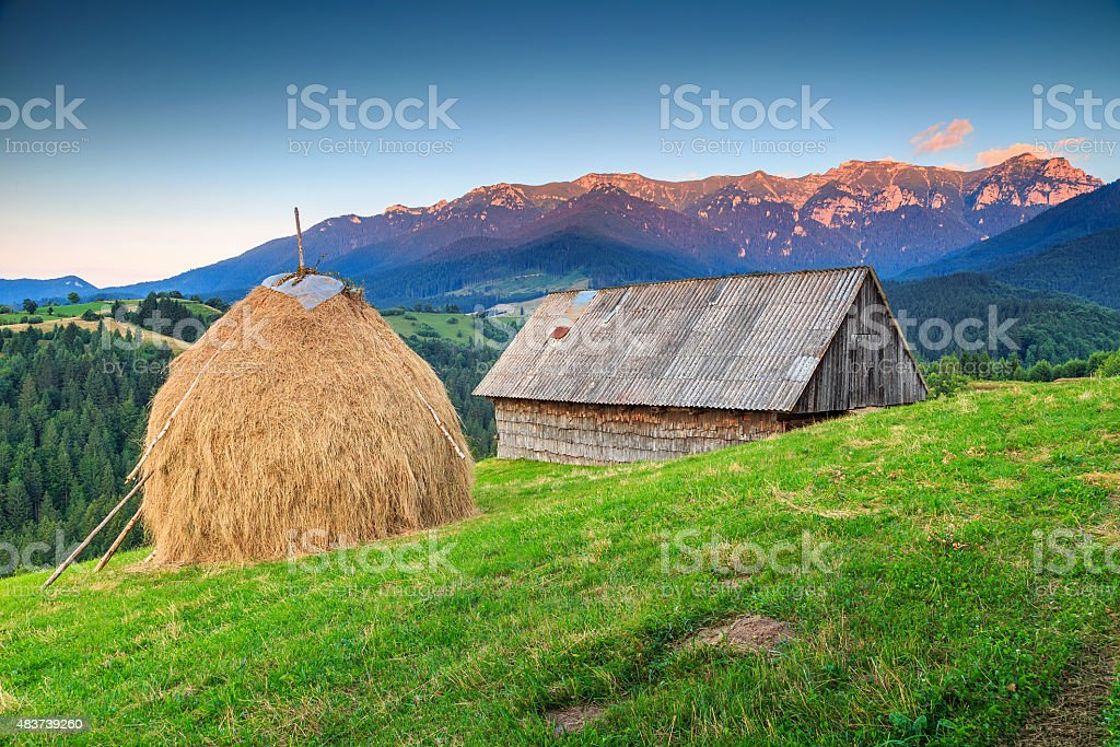 Alpine rural landscape with old wooden barn,Transylvania,Romania,Europe stock photo