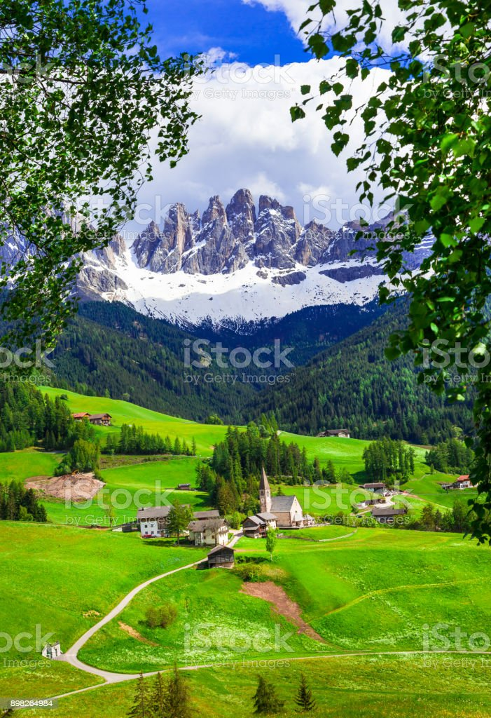 Alpine scenery - Dolomites mountains and traditional villages. Val di Funes, Italy stock photo