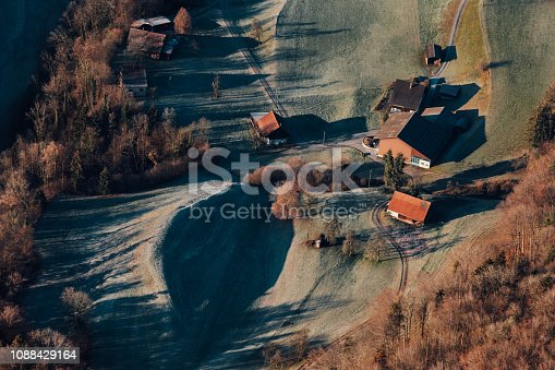 900763322 istock photo Alpine scenery from the air through the airplane window 1088429164