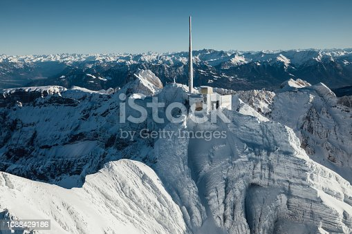 900763322 istock photo Alpine scenery from the air through the airplane window 1088429186