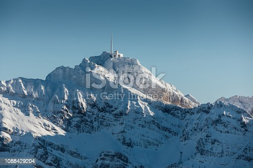 900763322 istock photo Alpine scenery from the air through the airplane window 1088429204