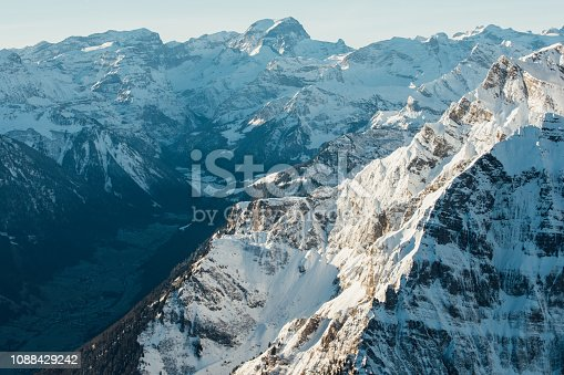 900763322 istock photo Alpine scenery from the air through the airplane window 1088429242