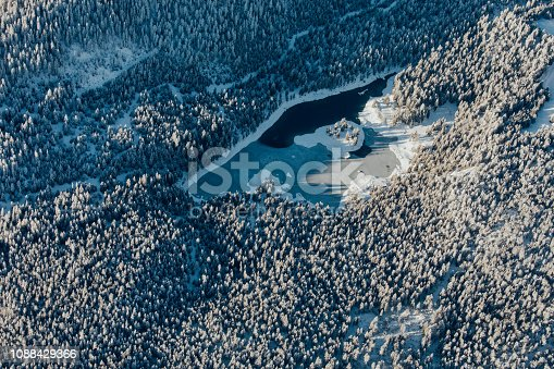 900763322 istock photo Alpine scenery from the air through the airplane window 1088429366