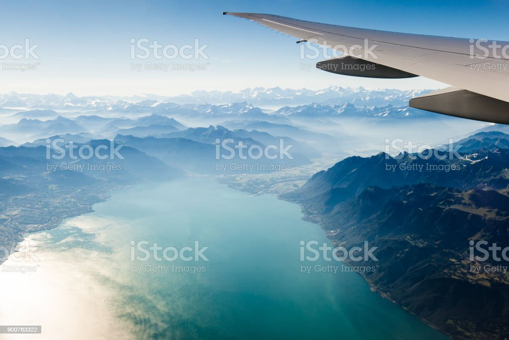 Alpine scenery from the air through the airplane window stock photo