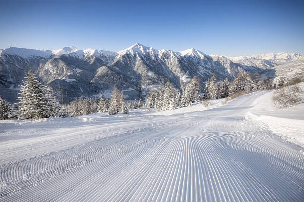Alpine Ski Area Freshly groomed slope in the Alps. davelongmedia stock pictures, royalty-free photos & images
