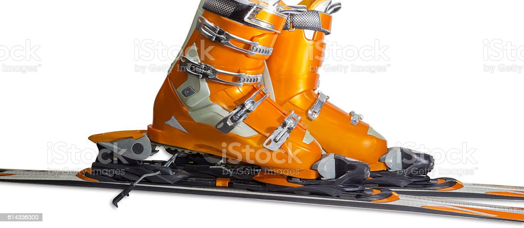 Alpine ski boots in ski binding closeup stock photo