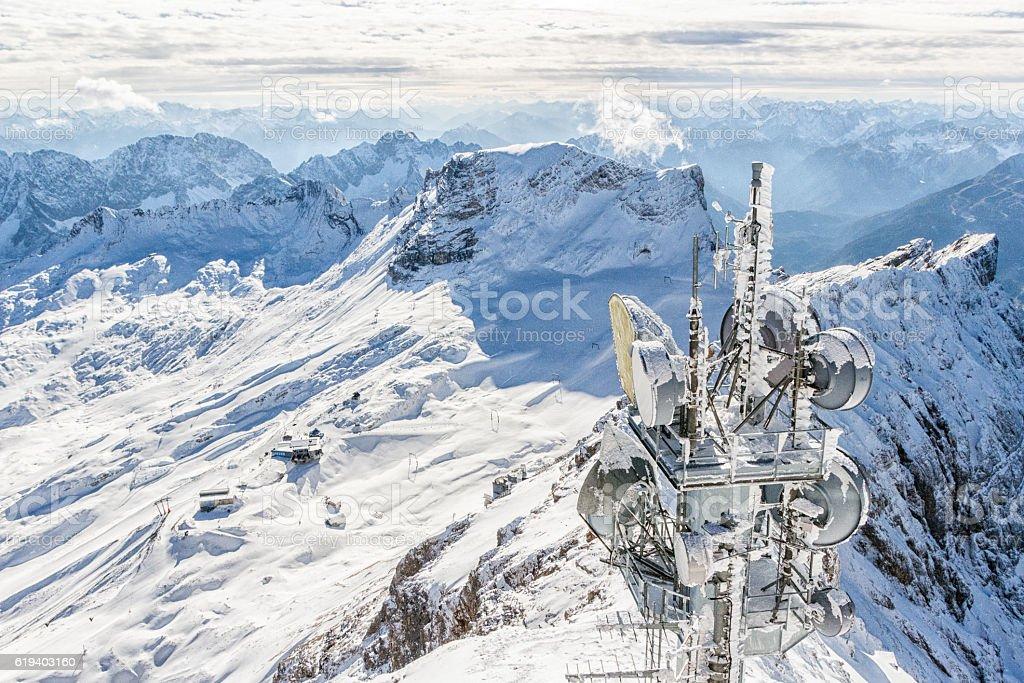Alpine ski region with antennas stock photo