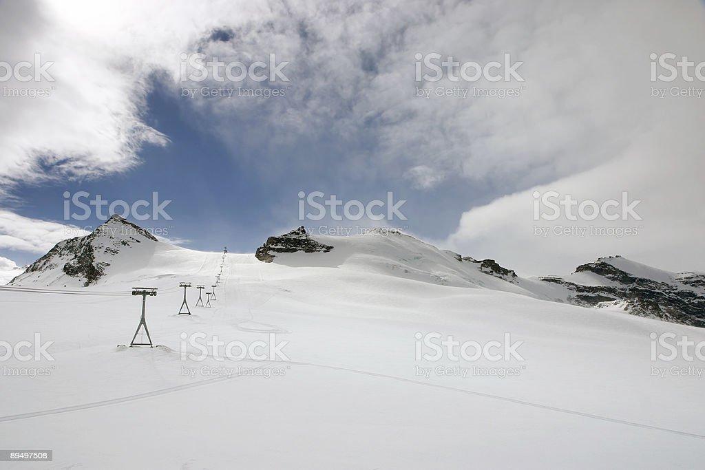 Les pistes de ski alpin photo libre de droits