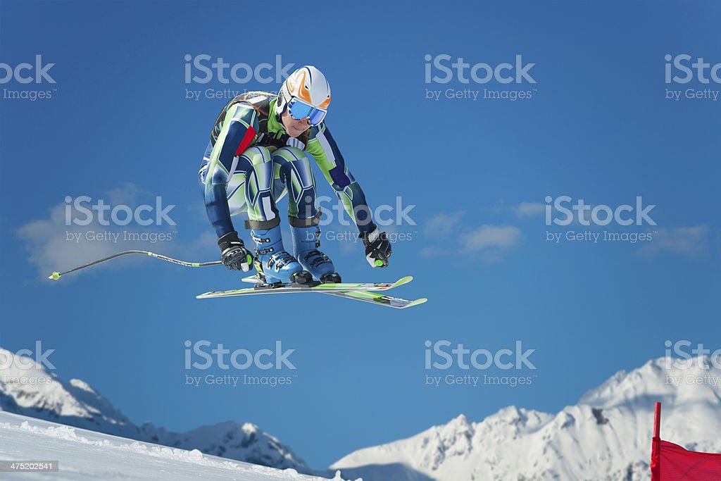Alpine Skier Jumping During the Straight Downhill Race stock photo