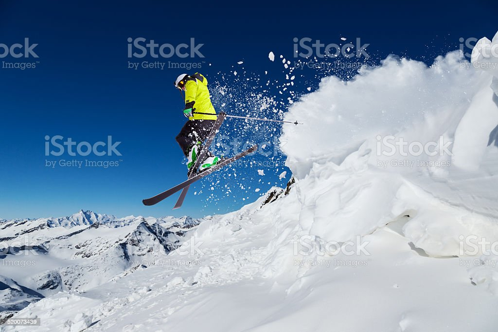 Alpine skier on piste, skiing downhill stock photo