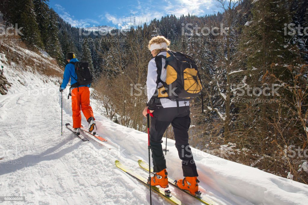 Alpine skiing with alpine guide instructor royalty-free stock photo