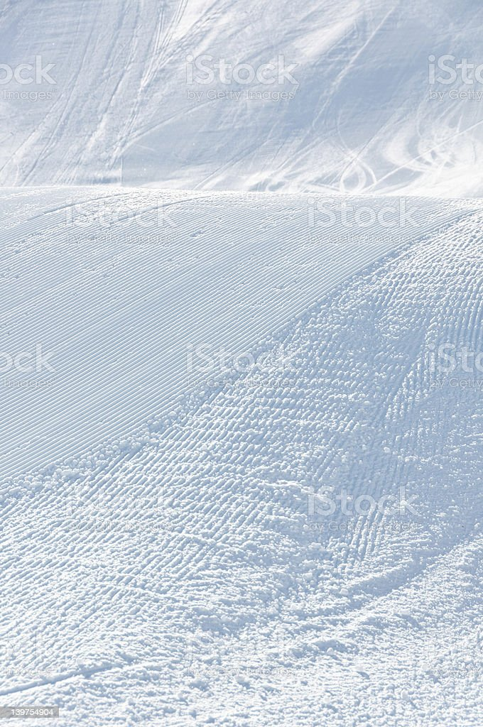 Alpine slope with ski and snowboard tracks royalty-free stock photo