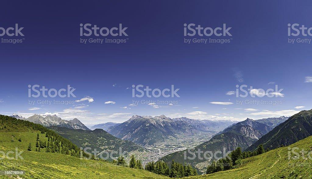 Alpine summer mountain meadow panorama Switzerland stock photo