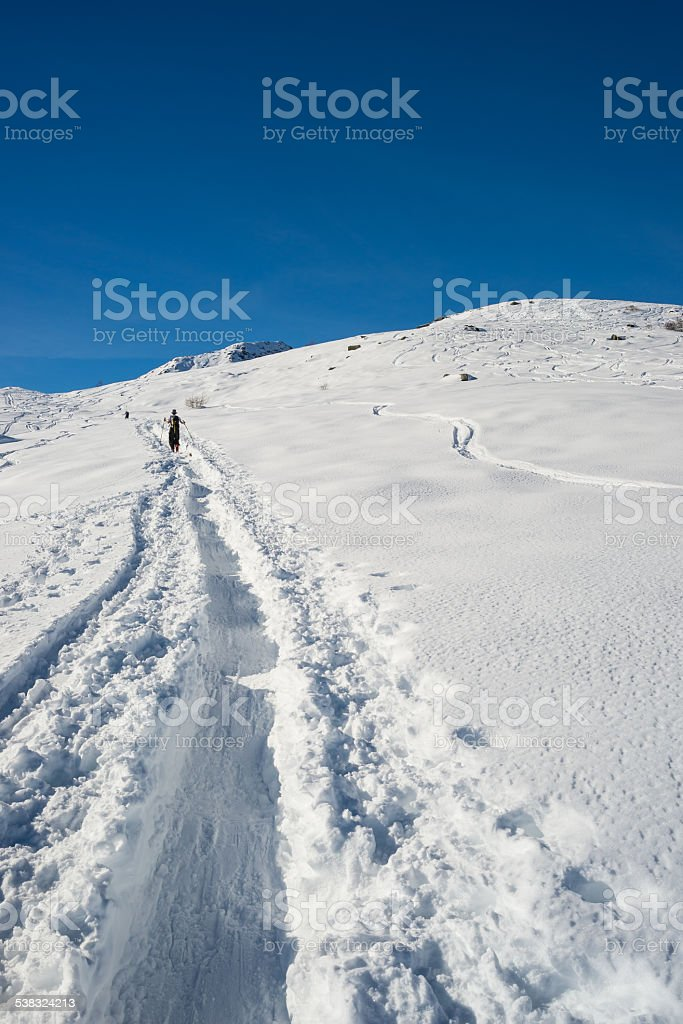 Alpine touring towards the summit stock photo