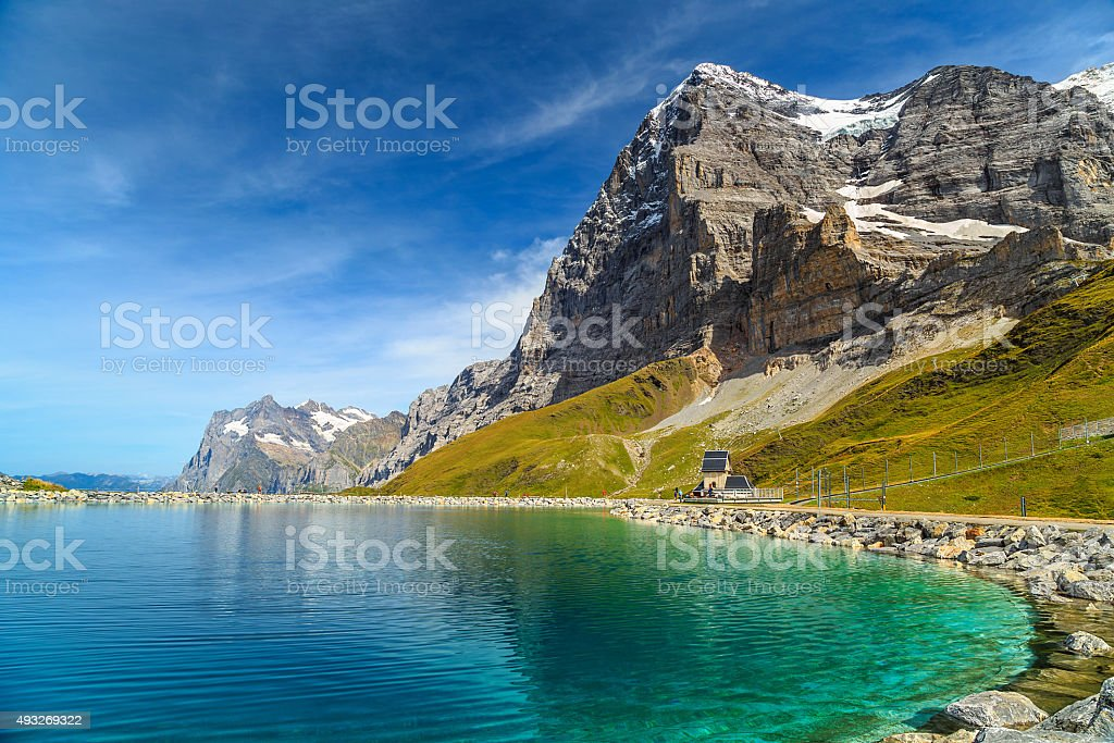 Alpine turquoise lake and Eiger North face,Bernese Oberland,Switzerland stock photo