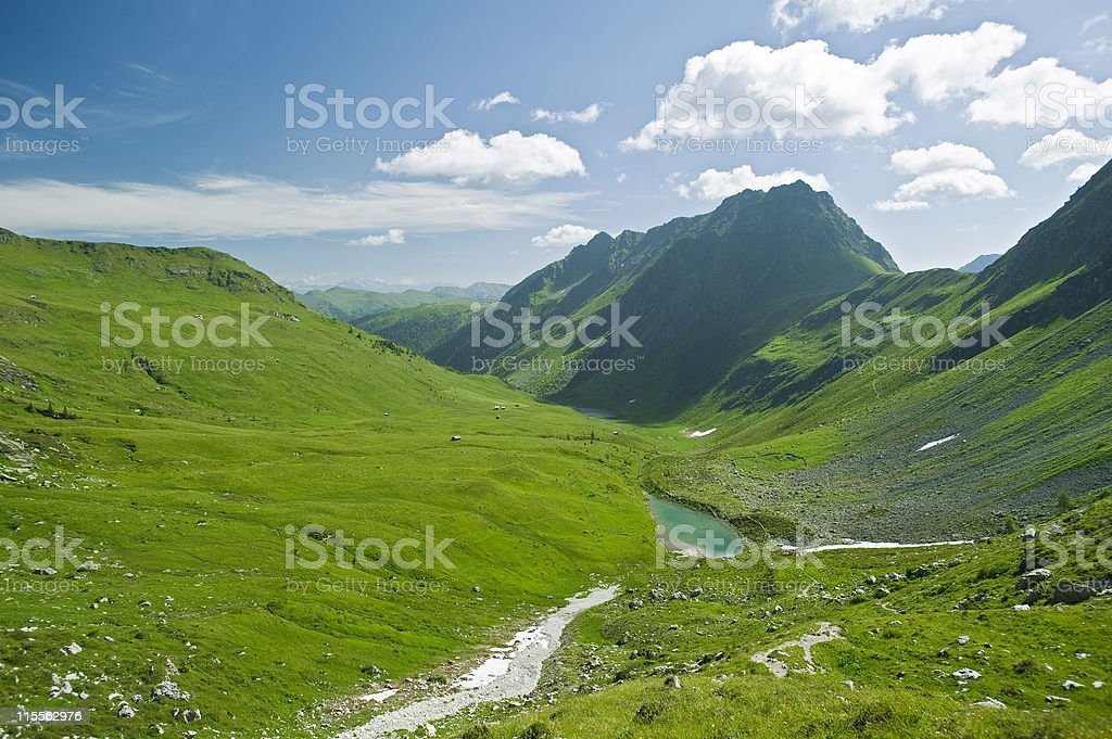 Alpine vale with mountains surrounding royalty-free stock photo