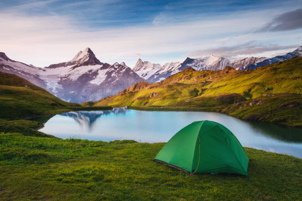 Alpine valley glowing by sunlight. Location place Bachalpsee in Swiss alps, Grindelwald.