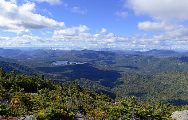 Alpine view from summit of a 46er, Adirondacks, New York Alpine view from summit of a 46er with vast forests clouds and wilderness in the Adirondack Mountains, New York State albany new york state stock pictures, royalty-free photos & images