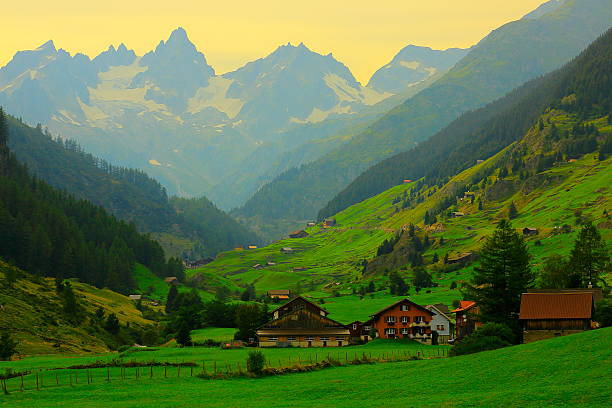 alpine village, bernese oberland swiss alps landscape, susten pass, switzerland - traumscheune stock-fotos und bilder