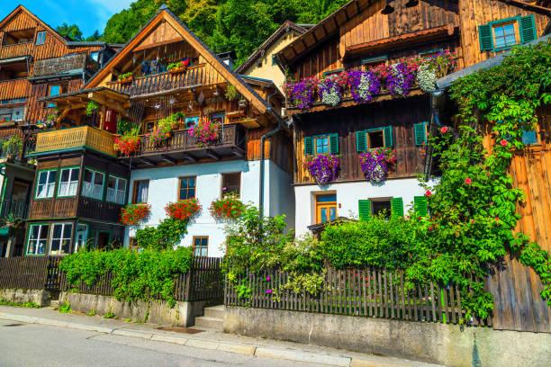 Alpine village street with flowery wooden houses, Hallstatt, Salzkammergut, Austria stock photo