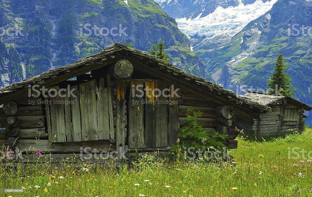 Alpine wood barns on  scenic mountain side,Switzerland stock photo