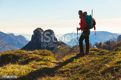 Hiker looking far a mountain peak