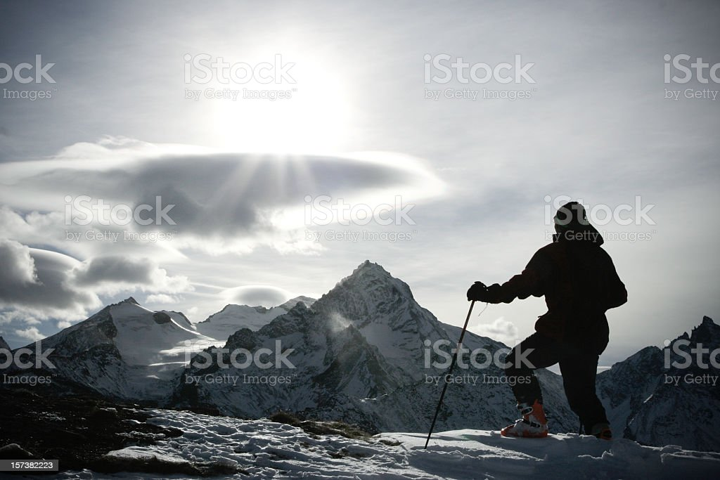 Alpinist on mountain top ready to go for the final peak royalty-free stock photo