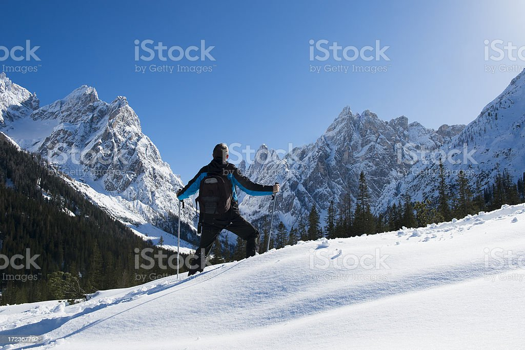 Alpinist on winter trip in the mountains using snow shoes royalty-free stock photo