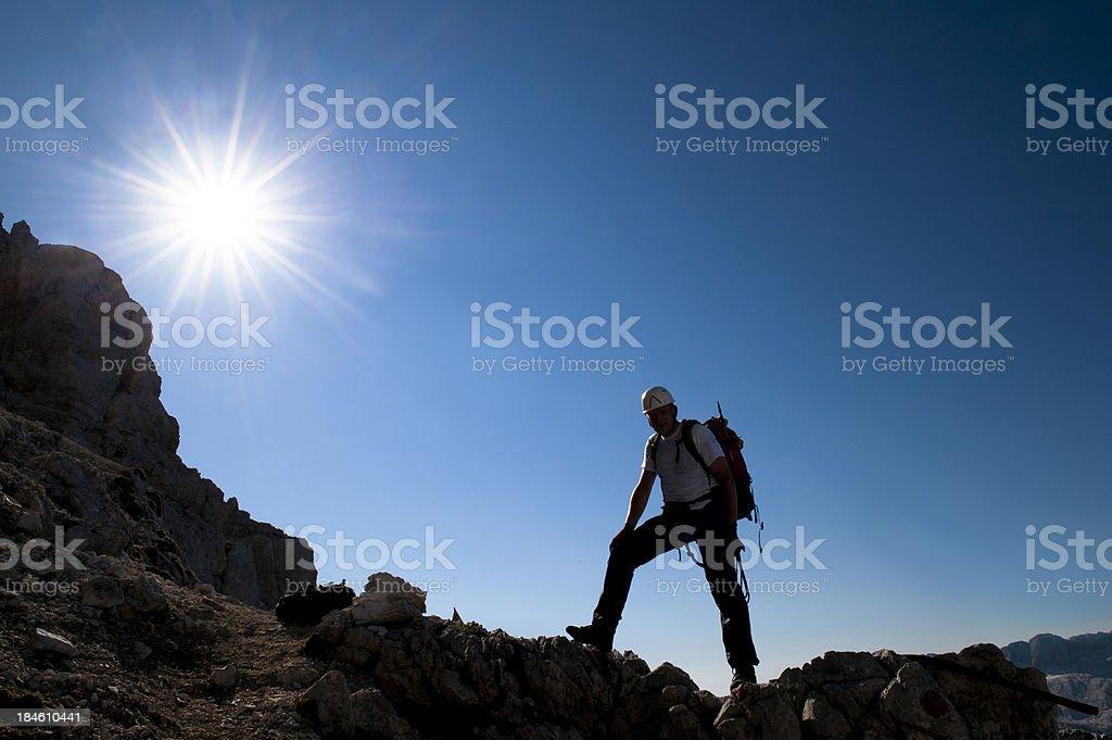 Alpinist reraching the mountain peak royalty-free stock photo