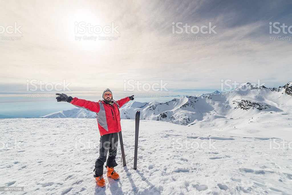 Alpinist with back country ski stock photo