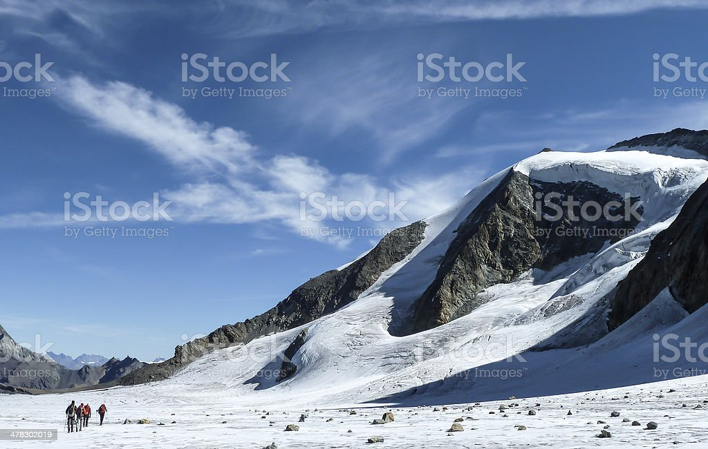 Alpinists crossing the Glacier du Gietro royalty-free stock photo