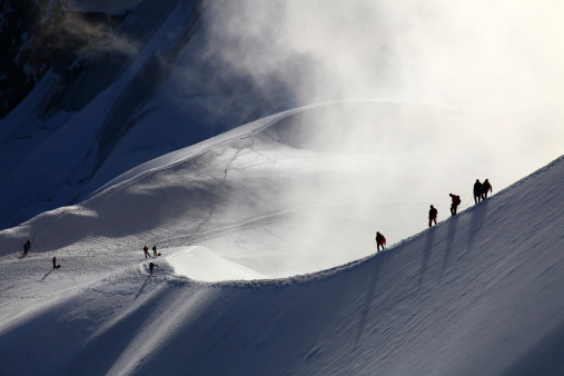 istock Alpinists making their way through snow drifts in mountains 177242328