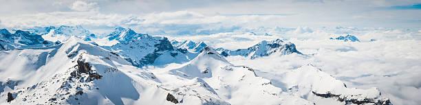 Alps above the clouds snowy summits Alpine peaks panorama Switzerland – Foto