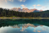 Alps lake landscape with forrest mountain, Lago di Carezza - Dolomites