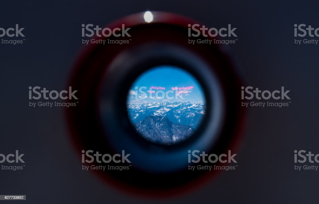 Alps mountain range looking from viewfinder of tourist binoculars on Zugspitze mountains stock photo