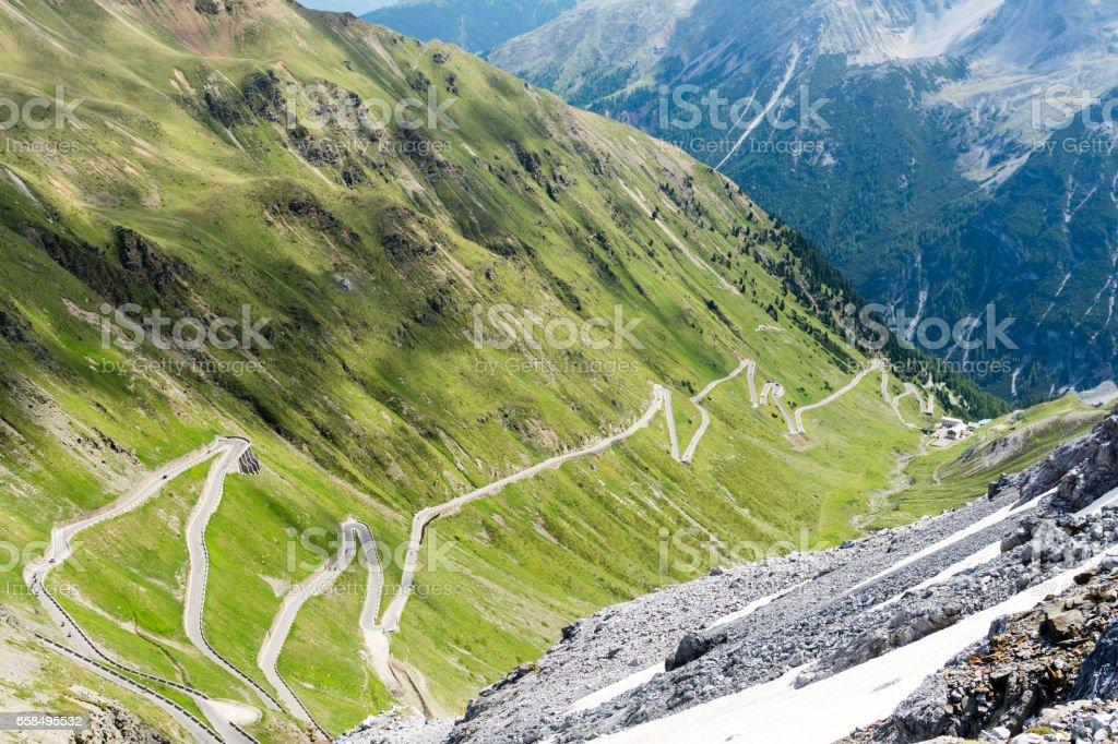 Alps mountain road Passo dello Stelvio famous for its auto and bike extreme driving. stock photo