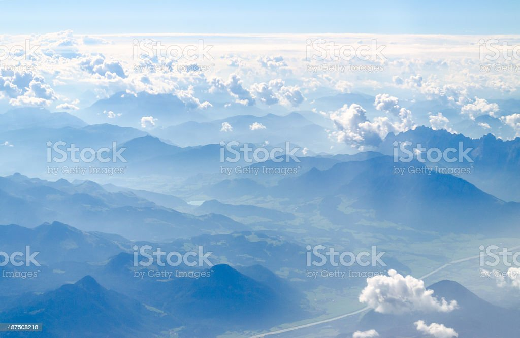 alps mountains top view from a plain stock photo