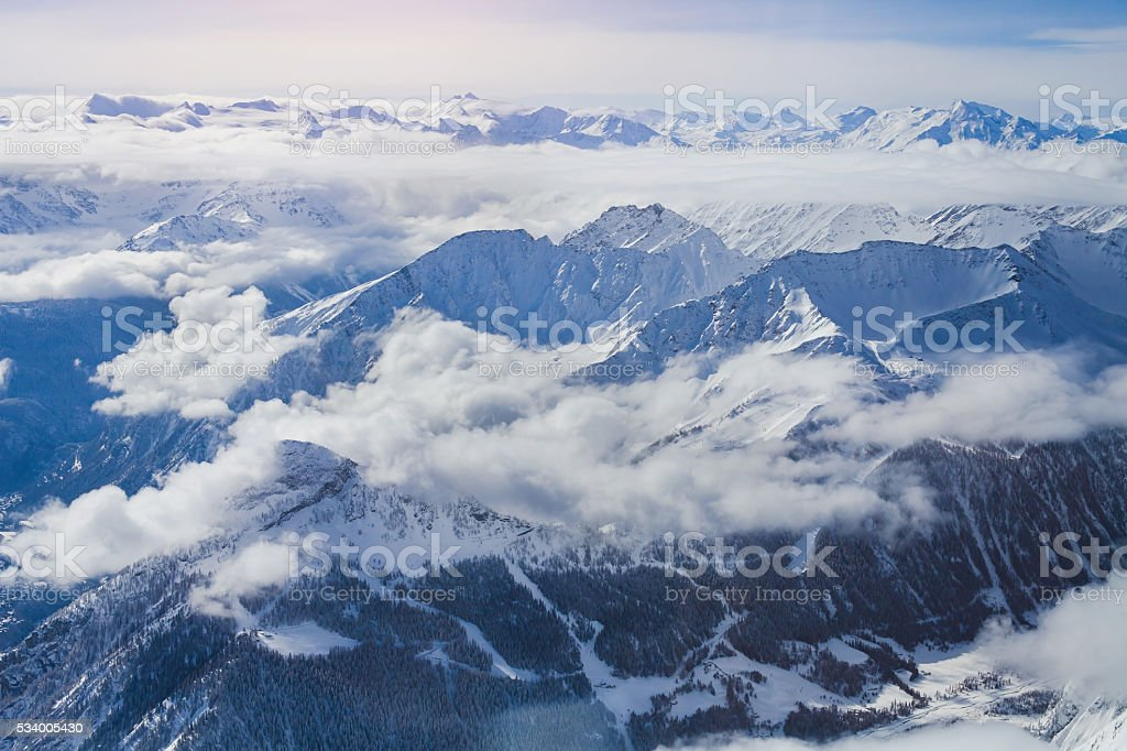 Alps, panoramic view of winter mountains stock photo