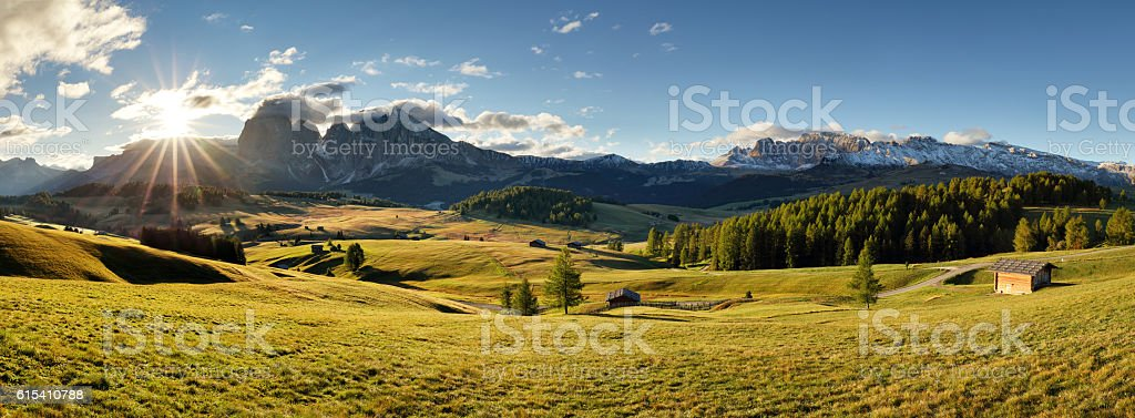 Alps sunrise green mountain panorama landscape, Alpe di Siusi stock photo