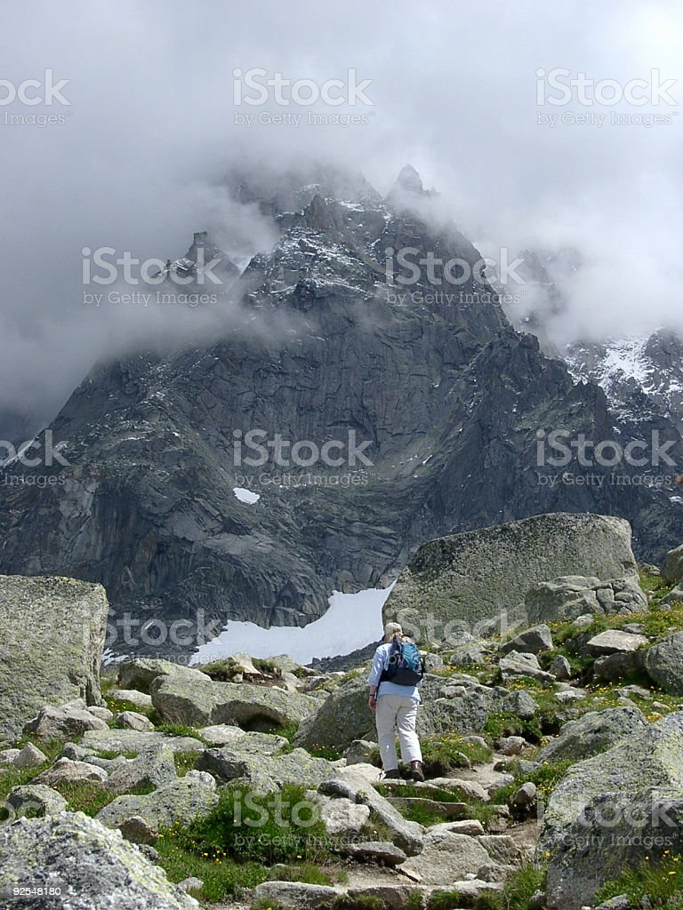 Alps, woman walking in mountain valley royalty-free stock photo