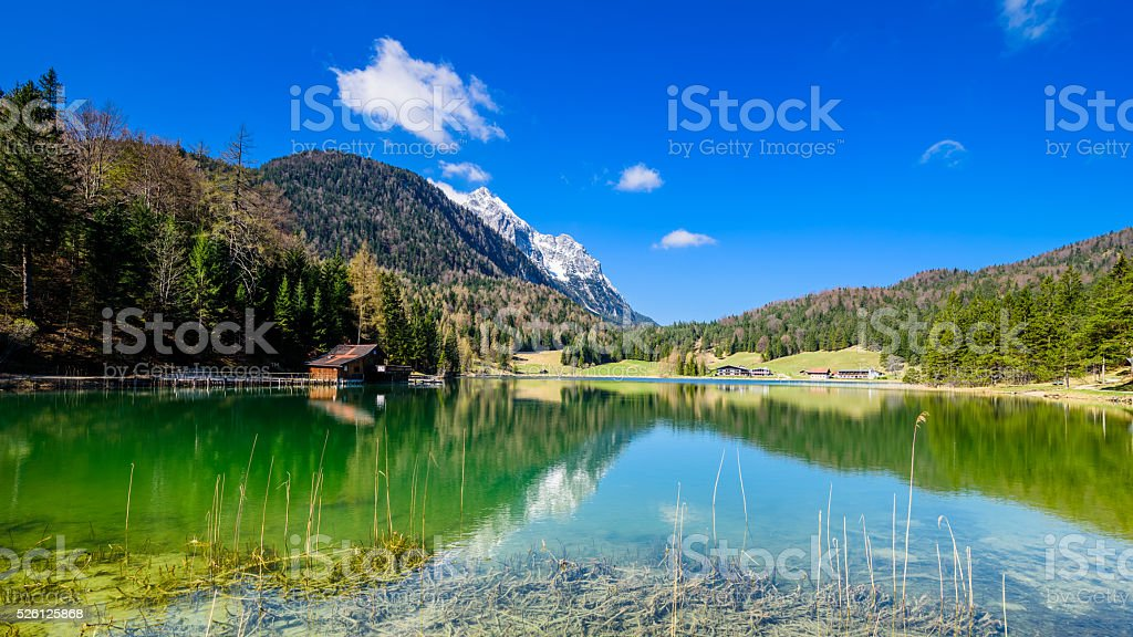 Alpspitze view from lautersee in mittenwald stock photo