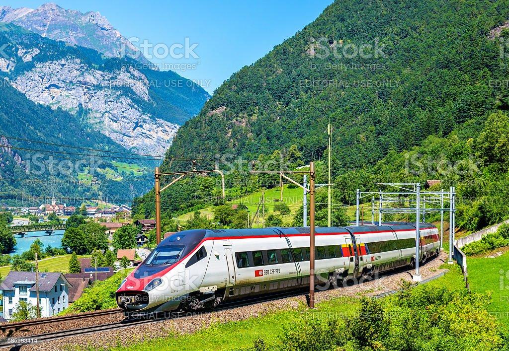 Alstom tilting high-speed train on the Gotthard railway stock photo