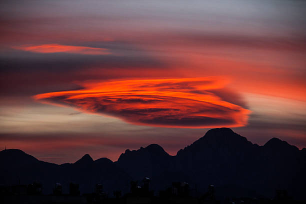 Altacumulus lenticularis sunset,Cumulus,altacumulus lenticularis, tratiformis, Radiatus, erlucidus, Stratus, cloud, Partly cloudy,red sky, mountain range, arbitrary stock pictures, royalty-free photos & images