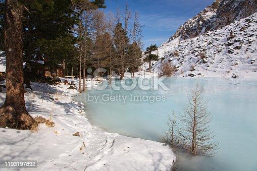 istock Altai mountain frozen lake with big stones 1193197892