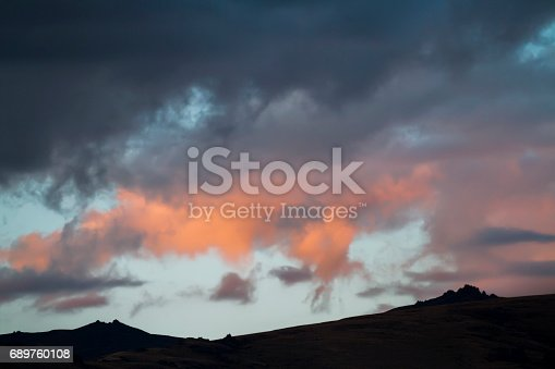 istock Altai Ukok the sunset over the mountains in cloudy cold weather. Wild remote places, no one around. Rain clouds over the mountains 689760108