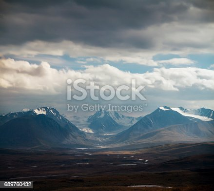 istock Altai Ukok the sunset over the mountains in cloudy cold weather. Wild remote places, no one around. Rain clouds over the mountains 689760432