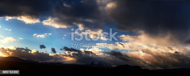 istock Altai Ukok the sunset over the mountains in cloudy cold weather. Wild remote places, no one around. Rain clouds over the mountains 689763392