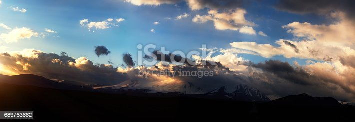 istock Altai Ukok the sunset over the mountains in cloudy cold weather. Wild remote places, no one around. Rain clouds over the mountains 689763662